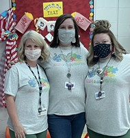 Teachers at Auburn dress up on World Autism Day